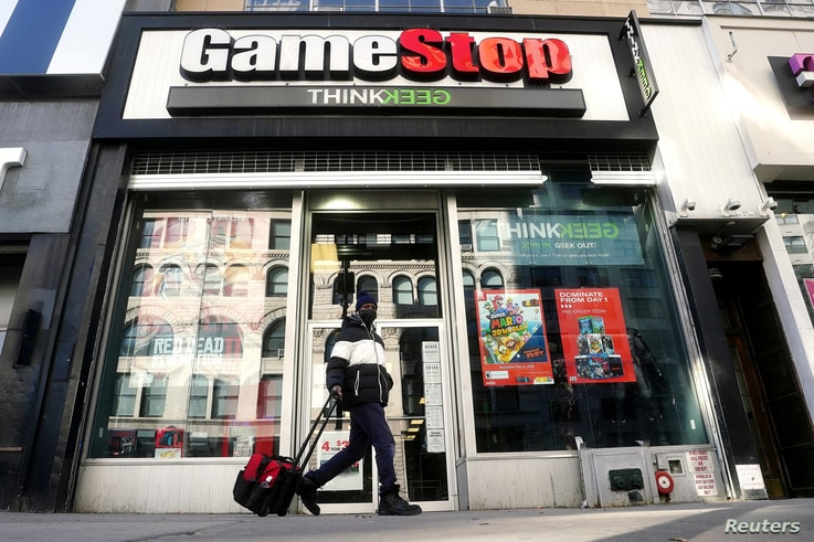 FILE PHOTO: A person walks past a GameStop store in the Manhattan borough of New York City, New York, U.S., January 29, 2021…