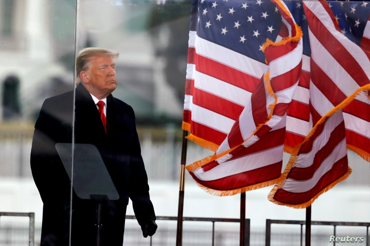FILE PHOTO: U.S. President Donald Trump looks on at the end of his speech during a rally to contest the certification of the…