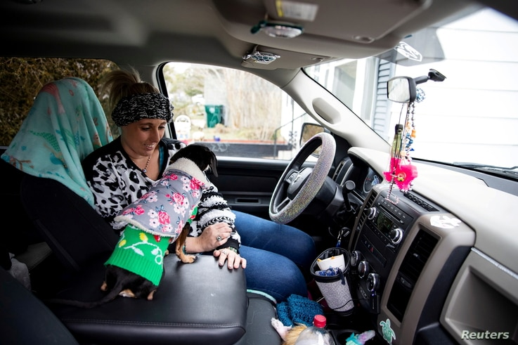 Laramie White, whose home was among the thousands in the city that were left without power after extremely cold weather moved…