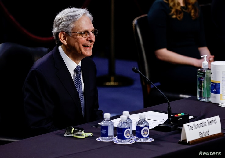 Judge Merrick Garland reacts as he testifies before a Senate Judiciary Committee hearing on his nomination to be U.S. Attorney…