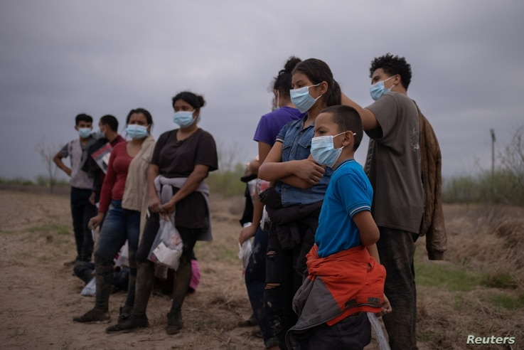 About a dozen asylum seeking unaccompanied minors from Central America are separated from other migrants by U.S. Border Patrol…