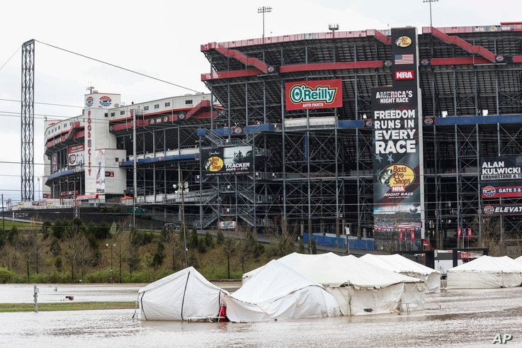 Damaged vendor tents sit in a flooded area near Bristol Motor Speedway as races for both the Truck Series and NASCAR Cup Series…