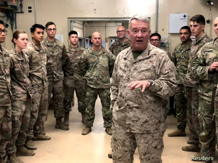 FILE PHOTO: Marine General Kenneth McKenzie, head of U.S. Central Command, speaks with U.S. troops while visiting Forward…
