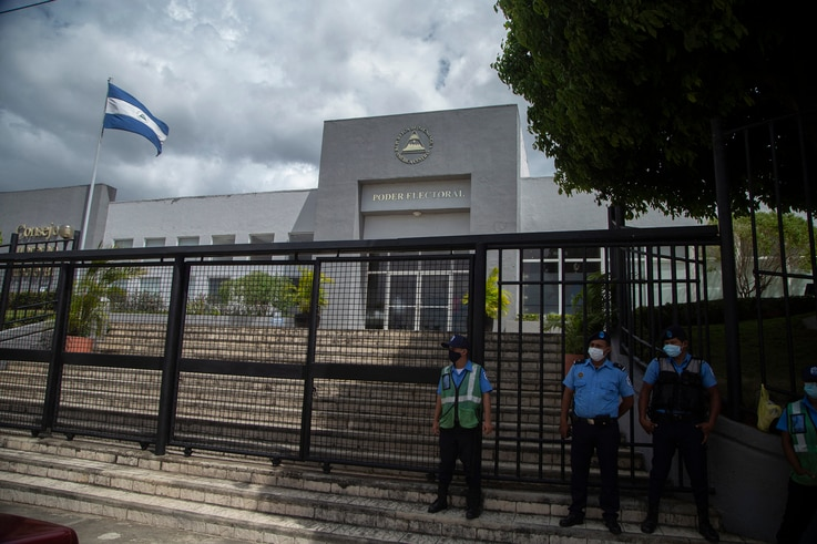 Police stand guard outside the Supreme Electoral Council in Managua, on May 12, 2021. - President Daniel Ortega's ruling party…