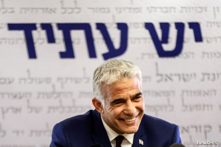 Yesh Atid party leader, Yair Lapid, speaks to the media in the Knesset, Israel's parliament, in Jerusalem, June 7, 2021…