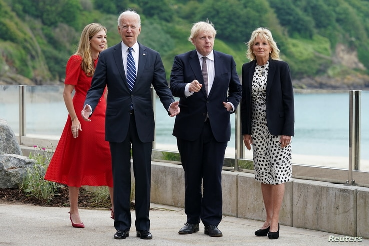 Britain's Prime Minister Boris Johnson, his wife Carrie Johnson and U.S. President Joe Biden with first lady Jill Biden stand…