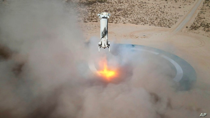 In this Jan. 14, 2021 photo made available by Blue Origin, the New Shepard NS-14 booster rocket lands at Launch Site One in…