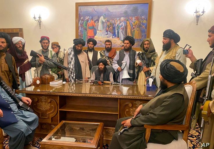 Taliban fighters take control of Afghan presidential palace after the Afghan President Ashraf Ghani fled the country, in Kabul,…