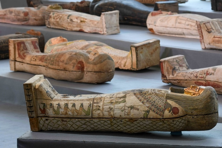TOPSHOT - A picture shows wooden sarcophagi on display during the unveiling of an ancient treasure trove of more than a 100…