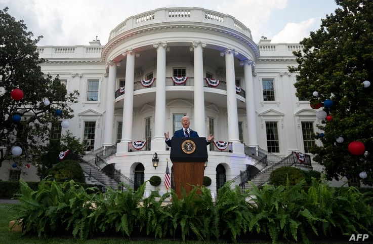 US President Joe Biden speaks during Independence Day celebrations on the South Lawn of the White House in Washington, DC, July…