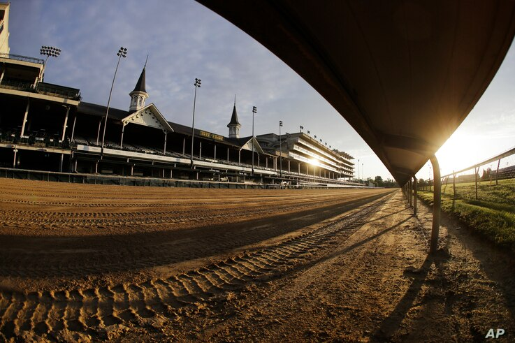 The sun rises over the track at Churchill Downs, Thursday, May 7, 2020, in Louisville, Ky. The Kentucky Derby has been…