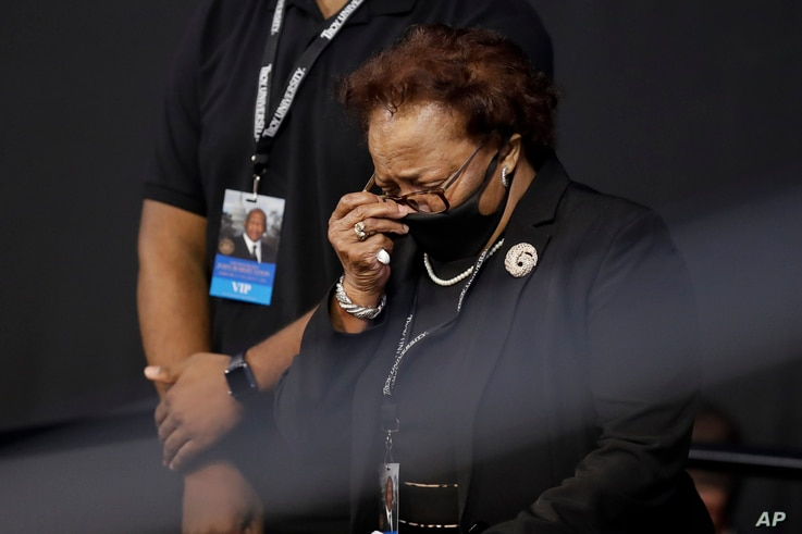 "Ethel Mae Tyner, sister, of the late Rep. John Lewis, D-Ga., wipes her face during a service celebrating ""The Boy from Troy"" at…"