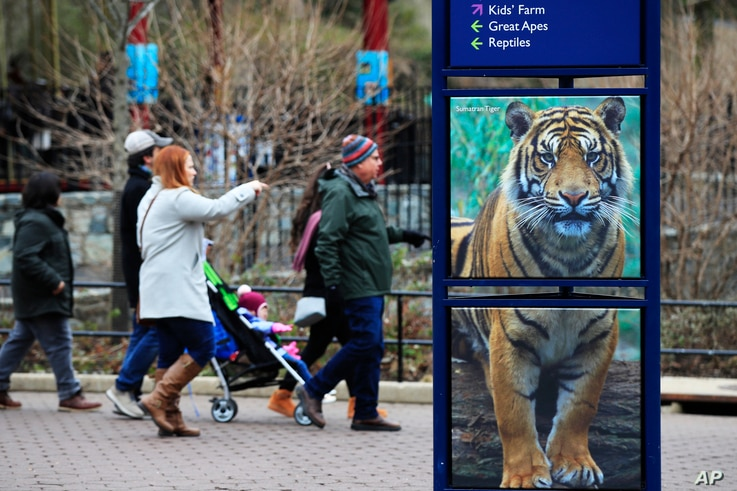 Visitors walk at the Smithsonian's National Zoo in Washington, Monday, Dec. 31, 2018. In the event of a prolonged government…