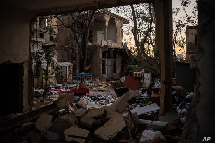 Rubble of destroyed buildings is seen Sunday, Aug. 16, 2020, in a neighborhood near the site of the Aug. 4 explosion in Beirut,…