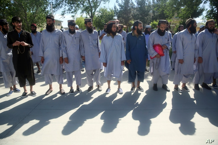 Afghan Taliban prisoners line up after their release from Bagram Prison in Parwan province, Afghanistan, Tuesday, May 26, 2020…