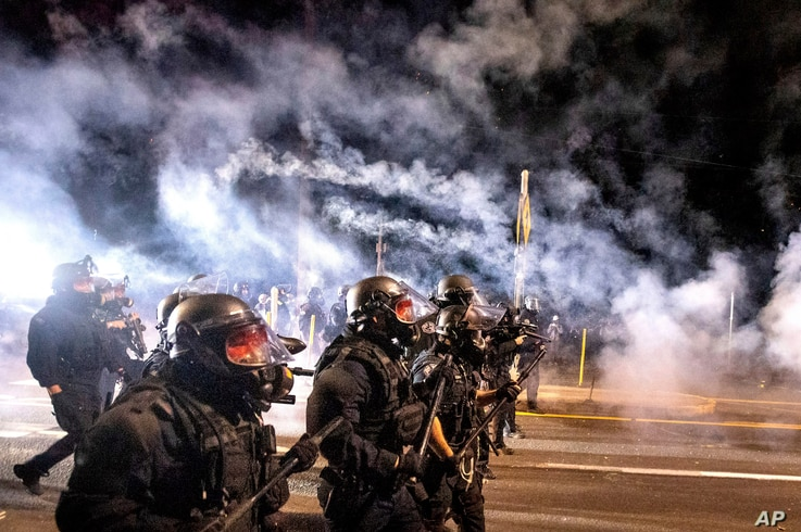 Police use chemical irritants and crowd control munitions to disperse protesters during the 100th consecutive day of…