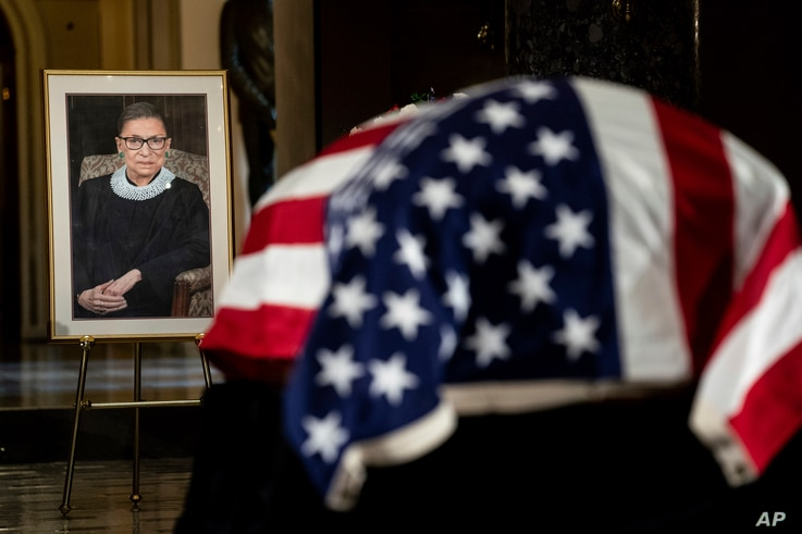 The flag-draped casket of Justice Ruth Bader Ginsburg lies in state in the U.S. Capitol on Friday, Sept. 25, 2020. Ginsburg…
