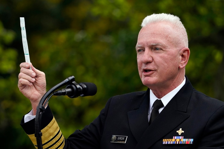 FILE - In this Sept. 28, 2020, file photo, Adm. Brett Giroir, assistant secretary of Health and Human Services, holds a swab…