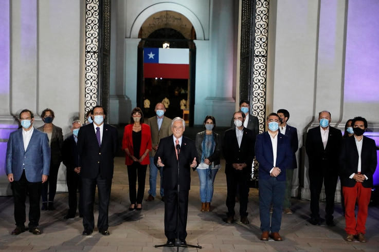 Chile's President Sebastian Pinera, center, speaks at La Moneda presidential palace on the day Chileans voted in a referendum…