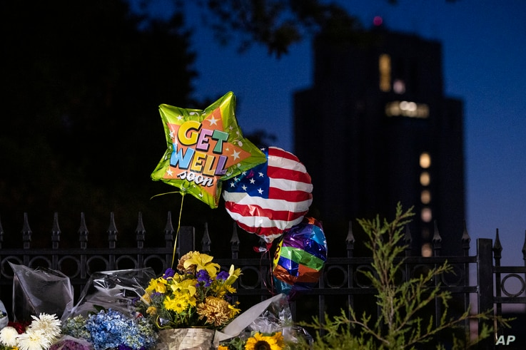 Flowers and balloons left by supporters of President Donald Trump at the entrance to Walter Reed National Military Medical…