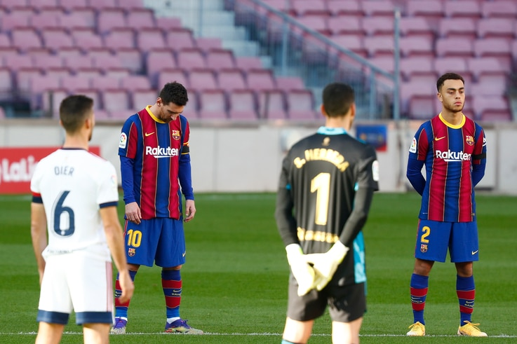FC Barcelona and Osasuna players observe a minute of silence in memory of soccer legend Diego Armando Maradona before the start…