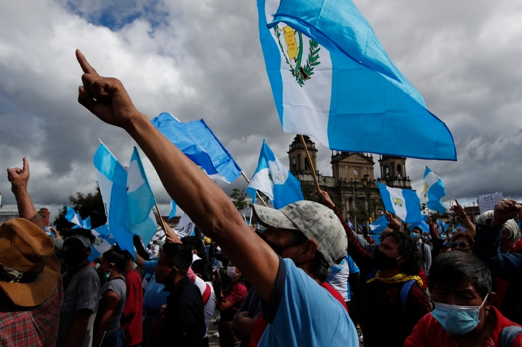 Protesters gather outside Congress in Guatemala City, Saturday, Nov. 21, 2020. Hundreds of protesters were protesting in…