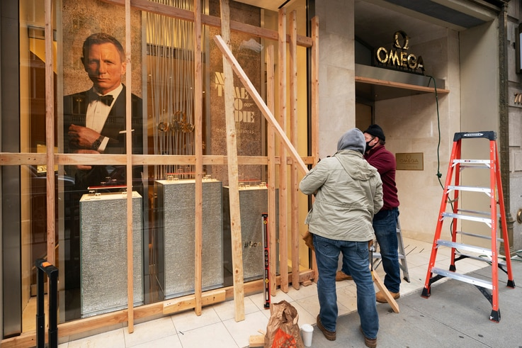 Workers board up an Omega store, Monday, Nov. 2, 2020, in New York ahead of Tuesday's contentious presidential election. The…