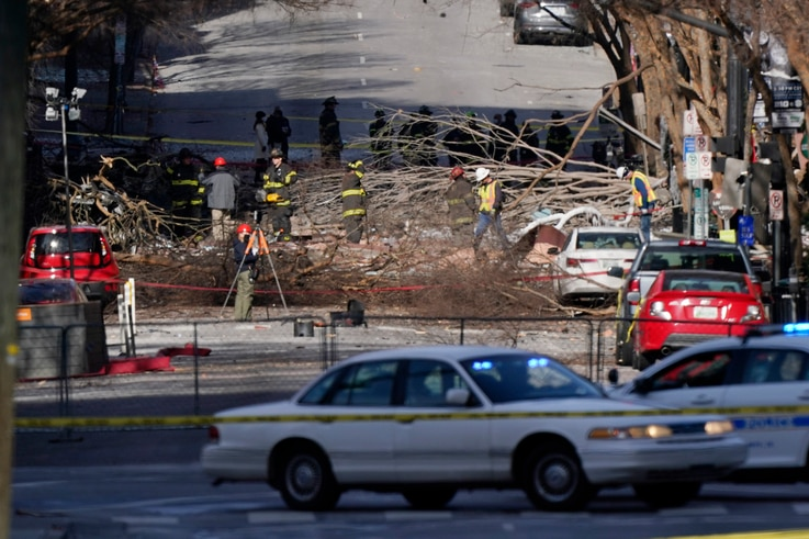 Investigators continue to examine the site of an explosion Sunday, Dec. 27, 2020, in downtown Nashville, Tenn. An explosion…