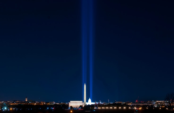 Spotlights along the National Mall in Washington celebrating the inauguration of President-elect Joe Biden and Vice President…
