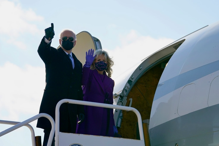 President-elect Joe Biden and his wife Jill Biden board a plane at New Castle Airport, Tuesday, Jan. 19, 2021, in New Castle,…
