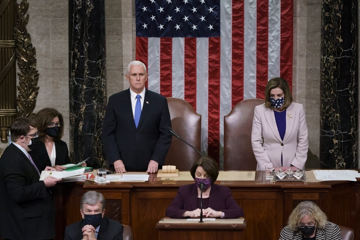 Vice President Mike Pence and Speaker of the House Nancy Pelosi, D-Calif., read the final certification of Electoral College…