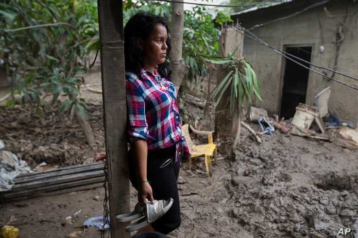 Nory Yamileth Hernandez stands at the property where she lived with 11 others, including her three teenage children, before it…