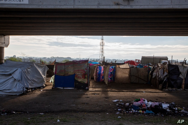 People who lost their homes in last year's hurricanes Eta and Iota live under tarps they set up under a bridge on the outskirts…
