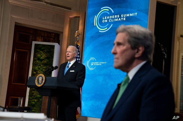 Special Presidential Envoy for Climate John Kerry listens as President Joe Biden speaks to the virtual Leaders Summit on…