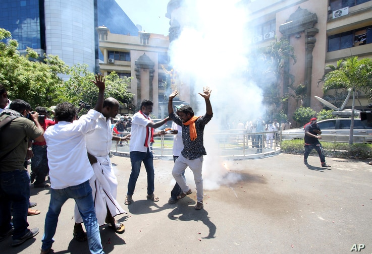 Dravida Munnetra Kazhagam (DMK) party cadres celebrate burn firecrackers as they celebrate early leads for the party in the…