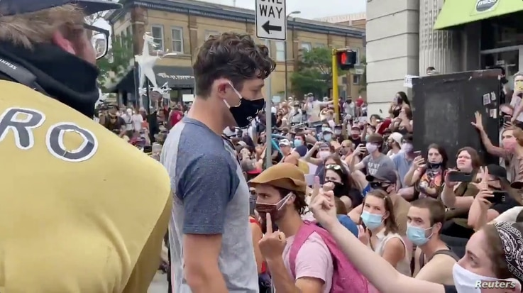 Social media video grab of Minneapolis Mayor Jacob Frey walking through a crowd of jeering protesters, in the aftermath of the death in Minneapolis police custody of George Floyd