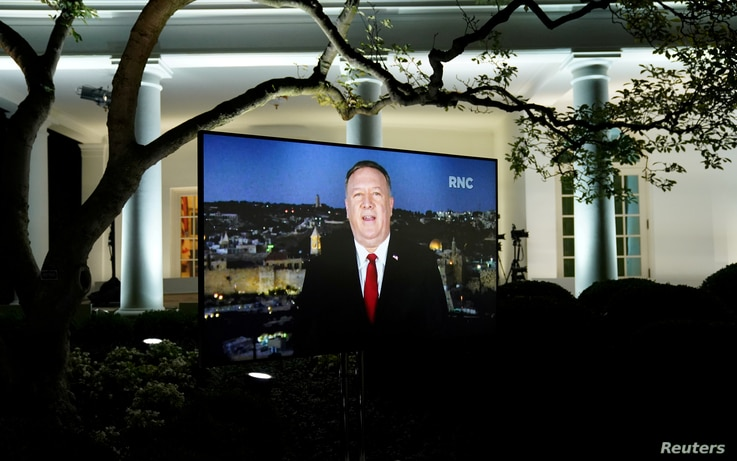 U.S. Secretary of State Mike Pompeo is seen giving his pre-recorded address to the 2020 Republican National Convention from Israel on a TV at the White House in Washington