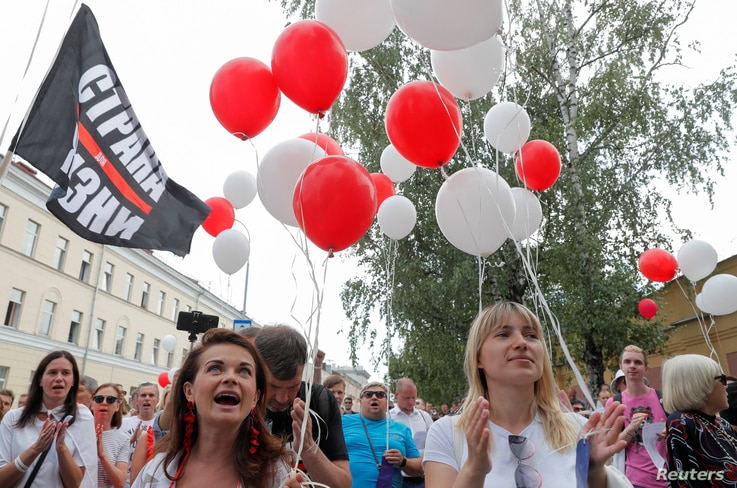 People take part in an opposition demonstration in support of Syarhei Tsikhanouski in Minsk