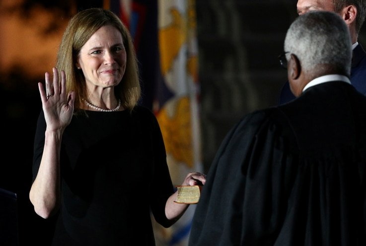 Judge Amy Coney is sworn in as an associate justice of the U.S. Supreme Court at the White House in Washington