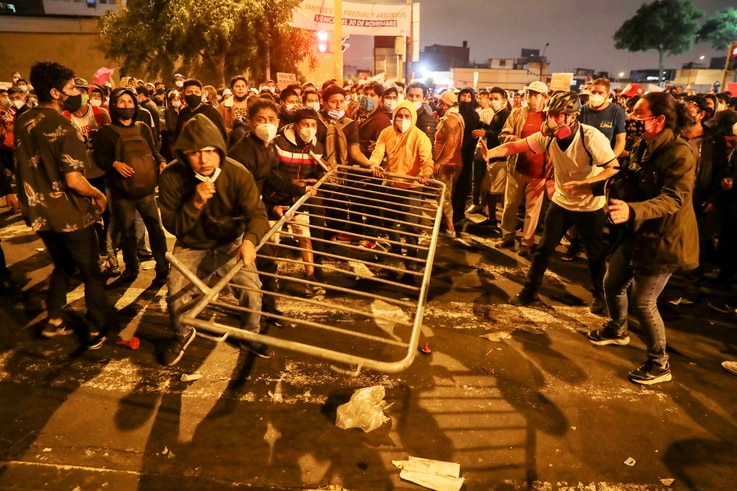 Demonstrators remove a barricade during protests following the impeachment of President Martin Vizcarra, in Lima