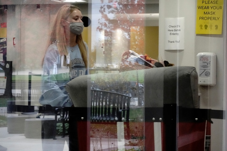 A University of Wisconsin-Madison student moves her belongings out of Witte Residence Hall, as the coronavirus disease (COVID-19) outbreak continues in Madison