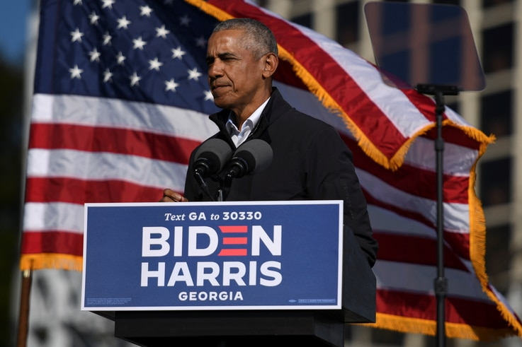 Former President Barack Obama addresses voters one day before the election, in Atlanta, Georgia