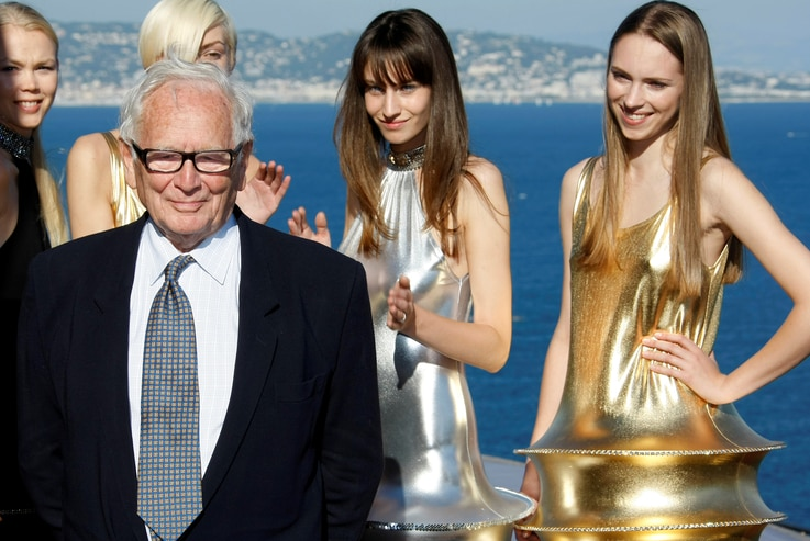 FILE PHOTO: French designer Pierre Cardin poses with models at the end of his 2009 spring/summer and autumn/winter ready-to-wear fashion collection show inTheoule-sur-Mer