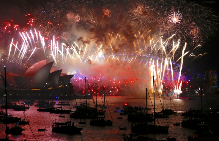 FILE PHOTO: Fireworks light up the Sydney Harbour Bridge and Sydney Opera House during new year celebrations on Sydney Harbour