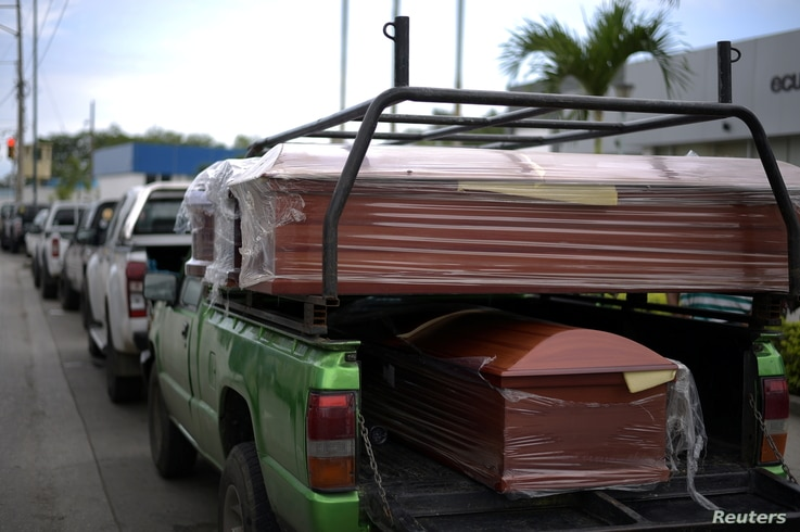 Coffins are seen outside the offices of the Forensic Medicine and Forensic Science institute, in Guayaquil