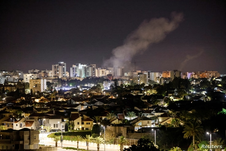 Smoke rises over houses in Ashkelon following a rocket attack launched from Gaza towards Ashkelon, southern Israel
