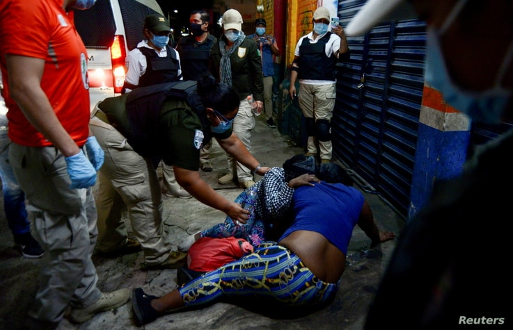 Agents of the National Migration Institute and National Guard detain migrants from Central America and the Caribbean, in Huixtla